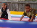 Joachim and Latifah in a bouncy castle, Fort Collins, Colorado, 2009