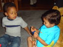 Joachim and Tariq with toys, Fort Collins, Colorado, 2009
