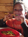 Joachim eating his vegetables in a cabin, Great Sand Dunes National Park, Colorado, 2010