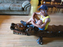 Joachim on a wooden alligator, South Bend, Indiana, 2011