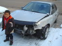 Joachim with totalled Toyota, Fort Collins, Colorado, 2010