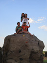 """Joachim, Tariq, Latifah and friend on a rock, CSU Rec Center"", Fort Collins, Colorado, 2011"