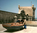 three men talking by a boat, Essaouira, Morocco, 1992