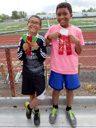 Joachim and Tariq with track meet ribbons, Fort Collins, Colorado, 2015